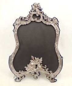 French style sterling silver picture frame with easel back, winged cherub decoration on top and below, high x 14 . on Jul 2014 Silver Picture Frames, Antique Picture Frames, Love Frames, Cherub, French Style, Antique Silver, Nostalgia, Auction, Clock