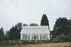 Starling Lane Vineyard has an enchanting greenhouse venue and a barn in Victoria, British Columbia. The charming old world farm location is filled with flower beds, greenery and vineyards. Photo: Shari + Mike Photography