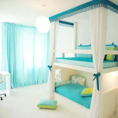 Awesome for kids who share a room. Beautiful bunk bed in a bright blue and white beach style