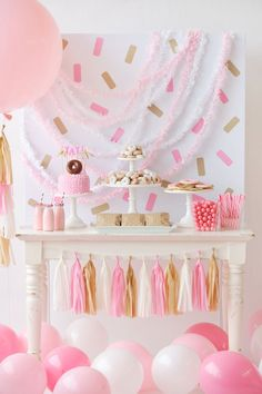 An adorable children's Donut themed Birthday Party that's perfect for a little girl or boy. Donut Decorations, donut party food ideas and a backdrop full of sprinkles. Creative birthday party inspiration from Happy Wish Company.