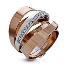 This bold, modern band is made from 18k rose and white gold with a central focus of .18 ctw of white diamonds.