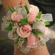 Corsage (Whoa! Those tiny flowers add some spunk to this pink and white corsage.)