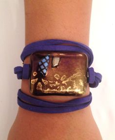 Murano glass bracelet - hand made -shining brwon and blue glass with dark blue soft leather - hand made -closing gold plated chain. by RachelGefenDesigns on Etsy https://www.etsy.com/il-en/listing/466340562/murano-glass-bracelet-hand-made-shining