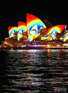 "Sydney Opera House, Sydney, Australia — by Caz and Craig @yTravelBlog. The""VividSydney""FestivalcomesaliveafterdarkeveryMay–June.Theadditionofhugelightprojectionsandlaserstransformsthecityi..."