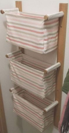 25 Cool DIY Projects And Ideas You Can Do Yourself - Wall hanging storage with 3 IKEA baskets; no instructions on site. Could this be made into a clothes hamper for a small space? Cool Diy Projects, Sewing Projects, Project Ideas, Woodworking Projects, Sewing Hacks, Woodworking Plans, Sewing Crafts, Home Crafts, Diy Home Decor