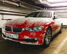 """It's no er, accident this """"distressed"""" white BMW 328 sedan from St Petersburg, Russia looks like it met a moose going the opposite direction one dark and stormy night. All it took was a LOT of blood red paint, the creative use of a paint sprayer, and an idea likely thought up over a bottle (or two) of vodka."""