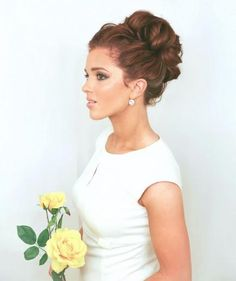 The Freckled Fox made this as a wedding hair tutorial, but it doubles nicely as a prom updo. The soft curls and mega volume make this look a stunner. #Prom #PromHair