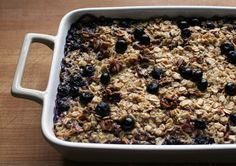 Baked Oatmeal (Mediterranean diet recipes)-  rolled oats; walnut pieces; natural cane sugar or maple syrup; aluminum-free baking powder; ground cinnamon; fine-grain sea salt; milk; egg; unsalted butter (or a substitute); pure vanilla extract; bananas;  huckleberries, blueberries, or mixed berries