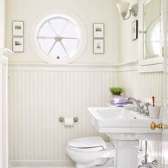 Crisp white paint, fixtures and beadboard create the illusion of space in this powder room. | Photo: Tria Giovan | thisoldhouse.com