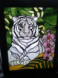 White Tiger - A 22x30 Stain glass tiger, lots of color in background  I think this is my finest work so far. It was fun, It sits in my window at home.