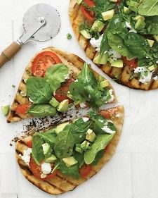 Grilled pizzas topped with avocado, fresh spinach, and goat cheese are a California dream come true.     Stretch the dough to whatever shape fits your grill most easily: round, oval, or even free form. Flipping a large round of dough on a hot grill can be tricky, so we made two smaller pieces and turned them over with tongs and a spatula -- no sweat.