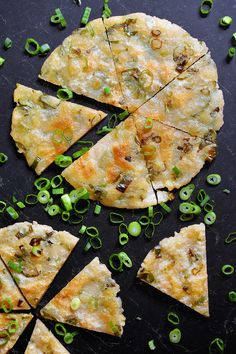 These paleo scallion pancakes are pretty much indistinguishable from the ones I used to order at my favorite Mandarin breakfast joints—only mine are vegan, grain-free, egg-free, nut-free, and fried in good fats! These crispy-on-the-outside, chewy-on-the-inside flatbreads filled with minced scallions are delicious!
