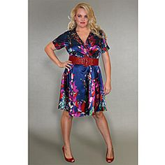 An abstract floral pattern in hues of navy, pink and green highlights this silky dress from INES Collection. Crafted with a touch of spandex, this knee-length women's dress features an adjustable waist sash for a flattering and comfortable fit.