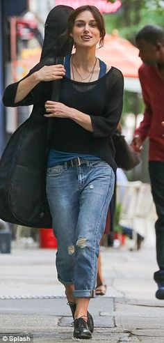 Casual style: Keira's character Greta dressed down in boyfriend jeans, a sheer jumper over a vest and brogues
