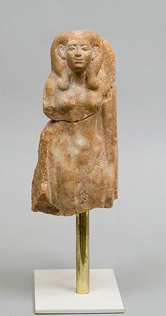Statuette Period: Middle Kingdom Dynasty: Dynasty 12–13 Date: ca. 1981–1640 B.C. Geography: From Egypt, Memphite Region, Lisht South, Mastaba of Senwosretankh, Pit 23 and Pit 8, MMA excavations, 1932–33 Medium: Quartzite Dimensions: h. 25 cm (9 13/16 in); w. 12 cm (4 3/4 in); d. 17.5 cm (6 7/8 in) Credit Line: Rogers Fund, 1933 Accession Number: 33.1.5a, b