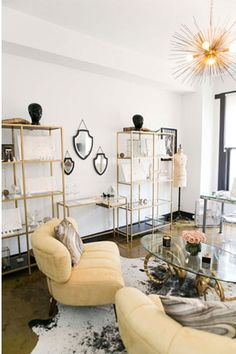 *gold and glass cabinets and desk: IKEA Vittsjo hacks!  gorgeous. (jewelry store interior)