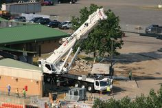 Cranes and other construction equipment in place along the third base side of PNC Field in Moosic.