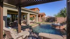 Escape to your #backyard, at The Hillary at Belmonte in Chandler, and enjoy a view of the #pool from under your #ramada!
