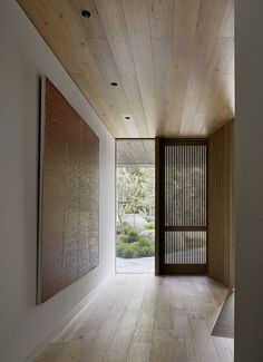 Light penetrates the building from different openings, such as these shutters that feature small slits, filling the house with natural sunlight