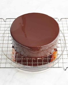"""Gelatin is the key to a glistening chocolate glaze that stays put on your cake. Jacques Torres prepared this recipe with Martha on Episode 501 of """"Martha Bakes."""""""