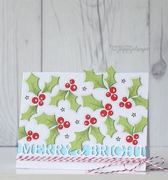 Hello crafty friends, Yoonsun here. Today I want to share with you my Christmas card using Holly Leaves and Berries and Merry and Bright Channel dies. To create this card: 1) Die cut Holly Leaves and Berries from red and green card stocks (several times) and then add some dark shading with a Copic marker C1. 2) Die cut Merry and Bright Channel from the bottom part of white paper panel. 3) Adhere all leaves and berries on die cut panel using double-side tape. 4) Mount finished die cut panel…
