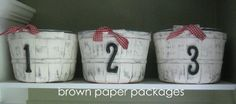 {painted apple baskets} for storage -- have the baskets, now just need an open shelf somewhere :)