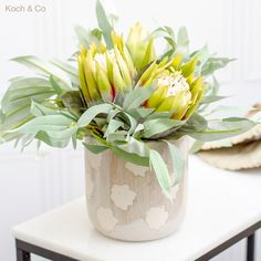 Simple native artificial floral arrangement, will suit any space in your home.