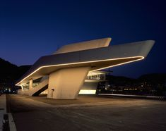 zaha hadid architect\'s ferry terminal in italy topped with asymmetric shell
