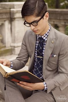 pattern mixing done right and the eyeglasses look good too.