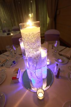 Wedding Centerpieces - use blue submersible led lights, clear crystals, baby's breath, and floating candles. Looks purple though! Lighted Wedding Centerpieces, Water Beads Centerpiece, Christmas Centerpieces, Wedding Decorations, Wedding Ideas, Manzanita Centerpiece, Quinceanera Decorations, Wedding Stuff, Wedding Flowers