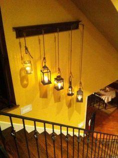 2. Hang several vintage lanterns or mason jar lamps to fill your plain wall.