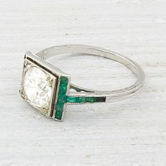 Wow. this is so cool! ruby would be fun in place of the emerald as well...although emerald is easier to coordinate day to day (for me at least!) 1.20 Carat Diamond and Emerald Vintage Engagement Ring from Erstwhile Jewelry Co.
