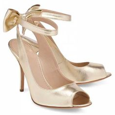 Moschino Cheap & Chic peep toe shoes.    Love that they're golden. Love the cute bow at the back.    £325