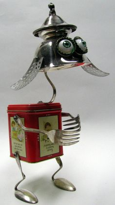 Sculpture created from a variety of found vintage/recycled objects. Size approx: 6 inches wide x 10 inches high x 7 inches long. One of a kind,
