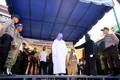 An elderly Christian woman has been caned in a conservative Indonesian province for selling alcohol, the first time someone from outside the Islamic faith has been punished there under strict religious laws.  The 60-year was whipped nearly 30 times with a rattan cane before a crowd of hundreds in Aceh