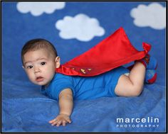 Who needs Superman when you have this SuperBaby -- Superhero photo. Five month old baby with superman customs, Baby boy photo idea, baby photo, blue background, five month old baby photo