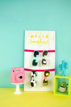 You all know how much I also love functional room decor. Why waste space with just style when you can have functionality too? We made thisHello Sunshine Sunglass Holder – Teen Summer Craft and it's perfect for displaying all your summer shades!