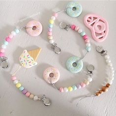 Pastel donuts & ice cream teethers are back! Both teethers & paci clips at spearmintLOVE.com