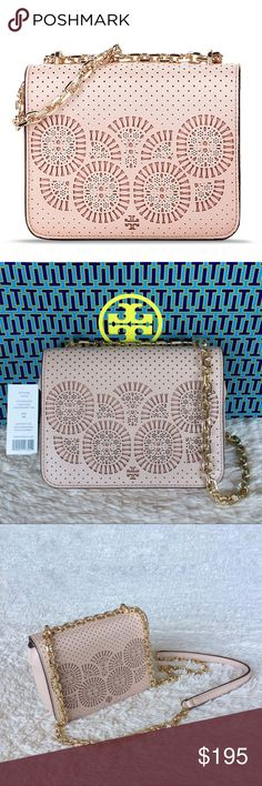 """NEW TORY BURCH ZOEY MINI LASER - CUT SHOULDER BAG Authentic. Brand new with tags. This bag will come with dust bag. Color: Light Oak and Gingersnap. PLEASE NO TRADE. THE PRICE IS FIRM. This bag can be worn as a shoulder bag or cross body bag. Tory Burch perforated leather shoulder bag with laser-cut pinwheels. Golden hardware. Chain shoulder strap can be doubled, 12""""-23.3"""" drop. Flap top with snap closure. Back slip pocket. Interior, three card slots. Logo jacquard lining. Tory Burch Bags…"""