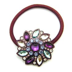 Emmaroi Pamela Ponytail Holder - Purple $19.50 from Cabbeet. http://www.cabbeet.com/hair-accessories/ties/emmaroi-pamela-ponytail-holder-purple