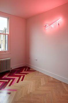 Renovated London apartments featuring multicoloured herringbone patterns.