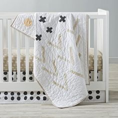 If you're looking for a crib bedding with a true touch of artistry, then our Freehand Crib Bedding is just for you. It's adorned with an illustrated pattern that was designed just for us by artist Ashley Goldberg. The quilt features designs that are hand painted by artisans, making every quilt completely unique and a true work of art.