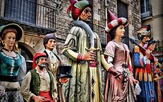 """El Gegant del Pi"" - Many Spanish festivals include costumed figures known as gigantes y cabezudos, roughly, ""Giants and Big-Heads"", or, in Catalan, gegants i capgrossos. The main feature of these figures is typically their papier maché head; bodies are covered in clothing matching the costume's theme.    These figures are particularly omnipresent in festivals of Catalonia, where many cities and towns have their own gegants i capgrossos, used in the cercavila and in conjunction with other…"