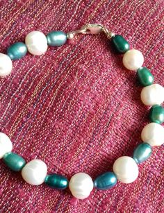 Teal and white Cultured Freshwater Pearl bracelet Freshwater Pearl Bracelet, Pearl Ring, Pearl Jewelry, Beaded Necklace, Beaded Bracelets, Sterling Silver Bracelets, Pearl White, Handcrafted Jewelry, Mermaid