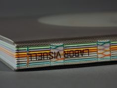 book binding #inspiration = like the idea of wrapping signatures in colored papers to divide book into segments