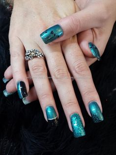 teal black and glitter freehand nail art over acrylic nails
