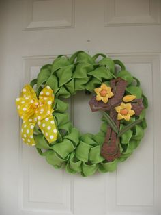 """Easter Fresh Green Faux Burlap Wreath with Metal Cross by TowerDoorDecor, $38.00 - Romans 5:8 """"but God shows His love for us in that while we were still sinners, Christ died for us."""""""
