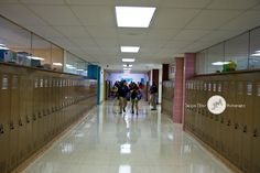 Students streaming into the building for the first day of school