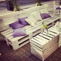 The idea to create the garden was simple: make a place where people can eat, talk, laugh and feel like home. We use old pallets, spools and box painted white and violet accessories. It turns out that
