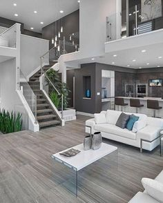 modern interior silver white sofa tall chairs tv stairs elegant floor plants modern lamps small table of Modern House Interior Design Ideas for Your Home